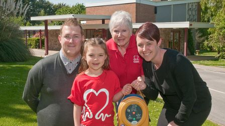 Weston Crematorium manager Laura Williams with BHF fundraiser Isabell Ware aged seven-years, BHF vol