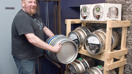 Andy Bidmead getting the kegs ready at The Black Cat. Picture: MARK ATHERTON