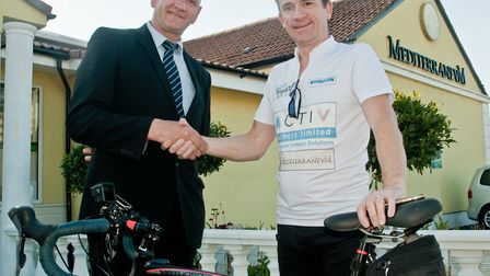 Phillip Howell with Catalin Ionita manager of the Mediterranevm restaurant which part sponsored Phil