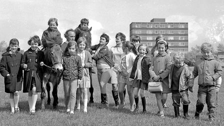Mr. and Mrs. Middle pictured with their ponies and some young visitors to Bournville Junior School S