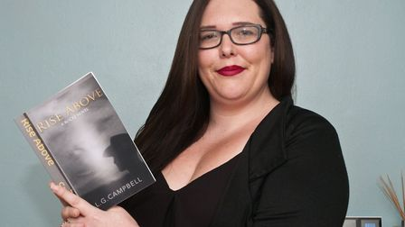 Self-published author Lauren Gallagher with her first book Rise Above. Picture: MARK ATHERTON