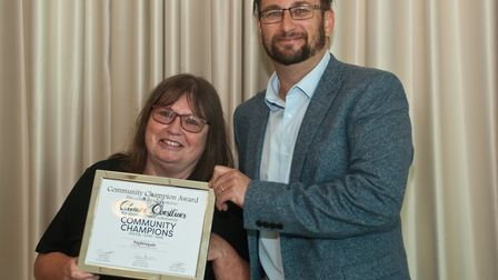 Simon Angear presenting Debbie Apted with the Cleaner Coastlines' Community Champions of Weston-supe