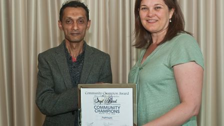 Fiona Cope presenting Sayd Ahmed with his Community Champion of Weston-super-Mare award. P