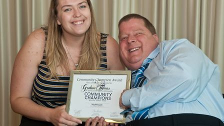 Eleanor Young presenting Graham Thomas with his Community Champion of Weston-super-Mare award.
