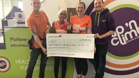 Team Bonds collecting a cheque for the Bone Cancer Research Trust..