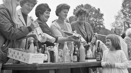 Six-year-old Donna Binning at the botttle stall at East Brent Church Fete. Picture: WESTON MERCU
