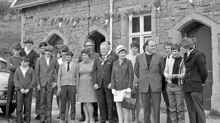 Old railway building makes new headquarters for Axbridge Youth Club. Pictured are members and guests