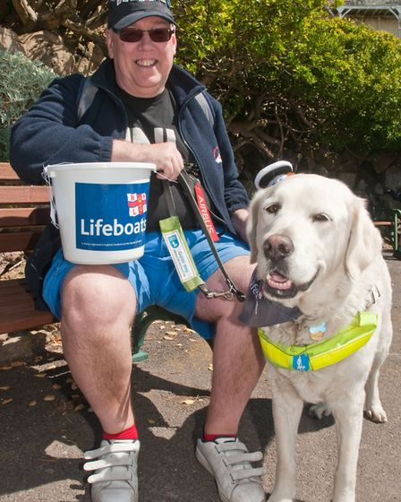 RNLI Lifeboat pull from Anchor Head along the promenade. Andrew Goddard and his guide dog. Pictur