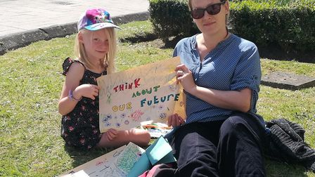 Anna Flint and her daughter Kaitlyn supporting the student climate strike. Picture: Gareth Newnham