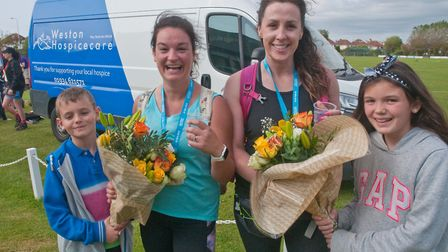 Flowers from family and friends for these returning 30 mile walkers. Weston Hopicecare Mendip Challe