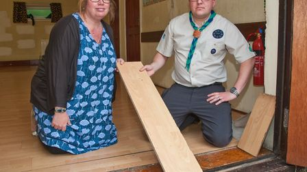 Group Scout Leader Ben Pink with Group chairman Lyndsey Kellow and the damaged flooring that needs t