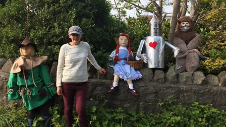 Beverley Rogers with The Wizard Of Oz scarecrows. Picture: Grant Rogers