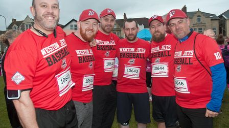 Weston Jets baseball team members taking part in Cancer Research UK's Race for Life on Weston Sea Fr