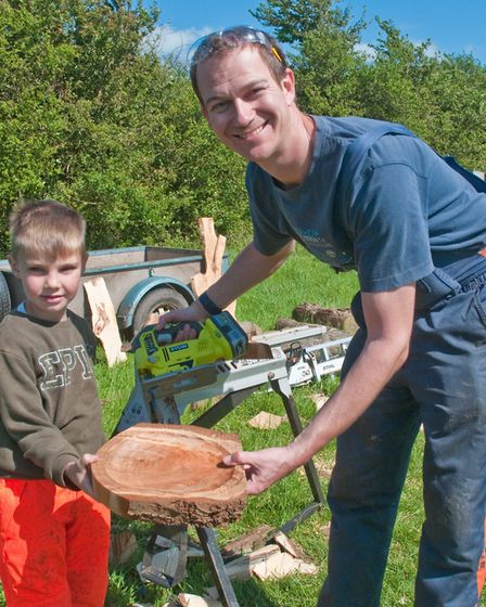 Ian Warriner making a bowl for 5-year-old Ralph Harris at the Fleece Fair. Picture: MARK ATHERTON