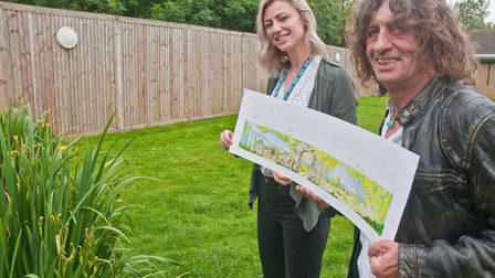 Kate Simmonds with artist Martin D'Arcy, in front of the fence they are hoping to paint. Picture: