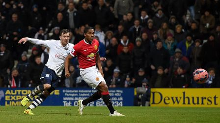 Scott Laird scores for Preston against Manchester United at Deepdale. Picture: Martin Rickett/PA