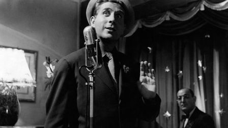 French actor, singer and songwriter Charles Trenet singing in Giovinezza. Italy, 1952 (Photo by Mond