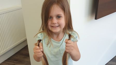 Alyssa Emery, aged 4, with the help of her parents gifted locks of her hair to the Little Princess T