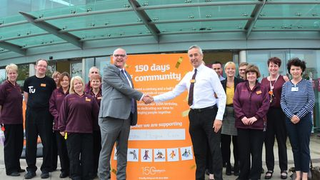 Manager Steve Kovacs and the Sainsbury's Worle team meet representatives of Weston Hospicecare to ce