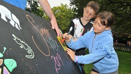 William 10 and Charlotte 8 doing stencil graffittiSt Paul's Church fun day in Clarence park, WsM.