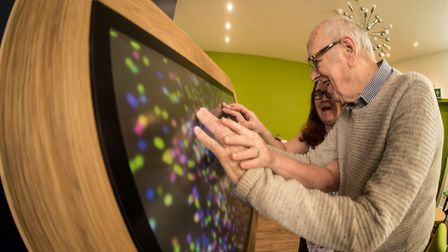 Activities co-ordinator April Lewis showing residents how to use the touch table.