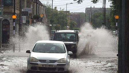Worle High Street was flooded in a storm on June 7. Picture: Timmay Curtis
