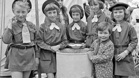 A group of brownies try the lucky dip at Congresbury Summer Fete and Rose Show. Picture: WESTON
