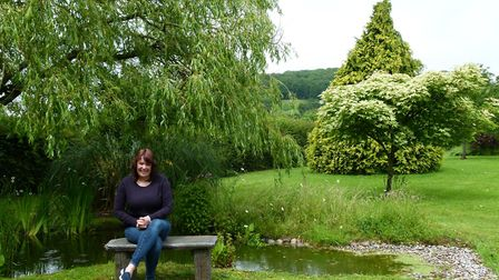 Tracey Saunders in her garden, which will feature in the open gardens day. Picture: Emily Saunders