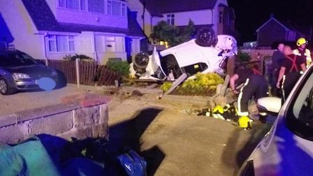 A car was found overturned in a front garden. Picture: Burnham Fire Station
