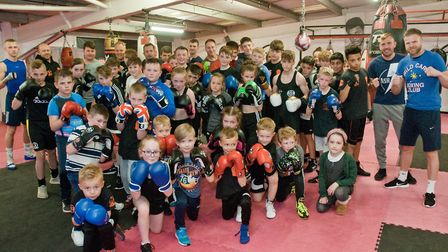 Members and youngsters at Warrior Gym with owner Dean Lewis (far right). Picture: MARK ATHERTON