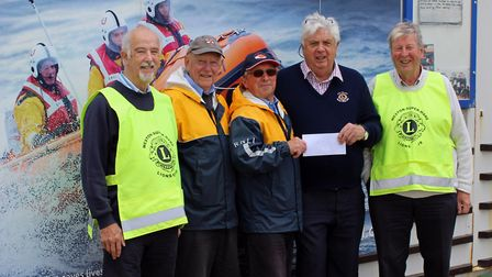 Weston Lions Club presents cash to the RNLI. Picture: Glyn Hayes