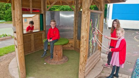 Birdwell School children around a playground hut, funded by the Co-op Local Community Fund. Pic
