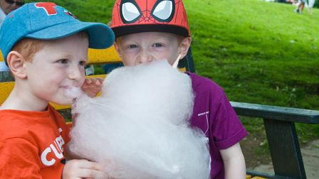Nathan and Callum sharing some candy-floss at Hannah More and Grove Junior School fair. Picture: