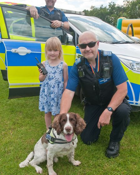 Jessica with PCSO's Chea Scandrett, Andy Gatenby and Police Dog Ollie at Hannah More and Grove Junio