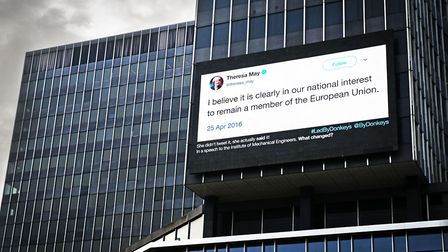 Theresa May's quote on a screen in Brussels' de Brouckere Place to remind the PM she supported Remai