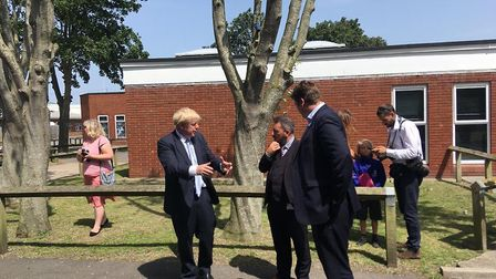 Boris Johnson with staff at King Alfred School in Highbridge. Picture: Weston Mercury