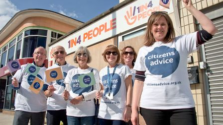 Citizens Advice chief officer Fiona Cope with staff and volunteers outside the former 1 in 4 People