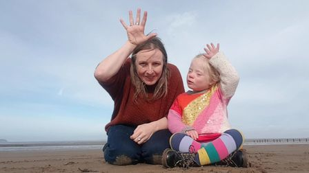 Nikki and Lucinda Holt using Makaton to tell the Snail And The Whale story.
