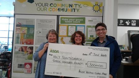 The cash was presented to the groups from Asda.