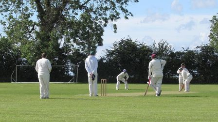 Frank Forge waits to bowl at a Chilcompton batsman during his spell of 3 for 24