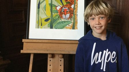 Sebastian Mann with his surprised by a tiger painting. Picture: Caroline Lucas