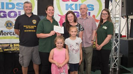 Weston Tennis Club receiving their cheque from ASquared Kate Bach and MC Tim Lamb at Weston Lions Cl
