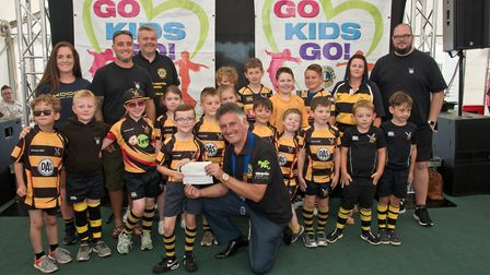 Hornets Rugby Club receiving their cheque from President Bob Jones and MC Tim Lamb at Weston Lions C