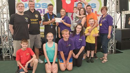 Boost rebound trampoline receiving their cheque from President Bob Jones and MC Tim Lamb at Weston L