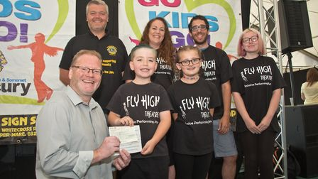 Flying High Perfoming Arts receiving their cheque from Richard Nightingale and MC Tim Lamb at Weston