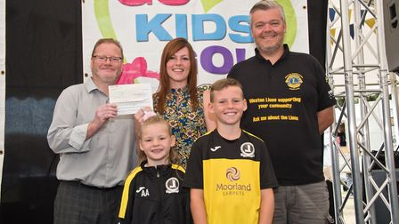 Priory Junior FC receiving their cheque from Richard Nightingale and MC Tim Lamb at Weston Lions Clu
