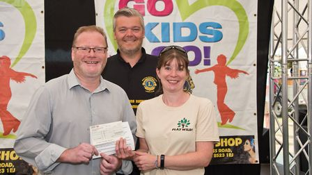 Play Wild! receiving their cheque from Richard Nightingale and MC Tim Lamb at Weston Lions Club Go K