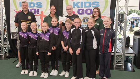 Weston Aerobic Gymnastic Club receiving their cheque from 4Square Kate Bach and MC Tim Lamb at Westo
