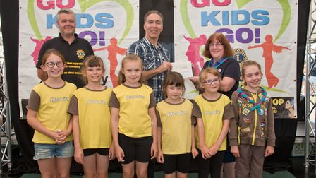 Locking Brownies receiving their cheque from Grand Pier's David Spear and MC Tim Lamb at Weston Lion