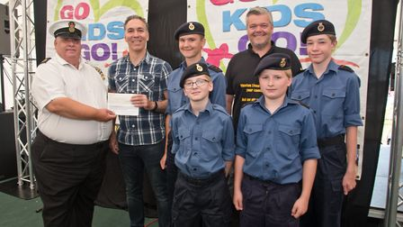 Weston Sea Cadets receiving their cheque from Grand Pier's David Spear and MC Tim Lamb at Weston Lio